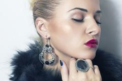 Stock Photo of beautiful blond woman.Jewelry and Beauty. Fashion.red lips