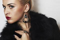 Beautiful blond woman in fur.Jewelry and Beauty Stock Photos