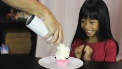Little Asian Girl Gets Special Birthday Cupcake Stock Footage