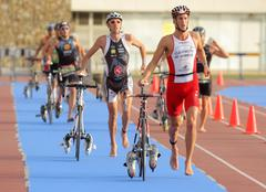 Triathletes on transition zone - stock photo