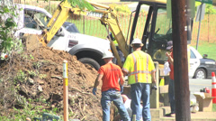 Workmen in the street new traffic pattern Stock Footage