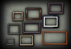 Green grungy wall full of wooden picture frames Stock Illustration