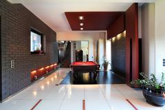 Modern interior with billiard table Stock Photos