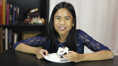 Cute Asian Girl Eating Birthday Cupcake Stock Footage
