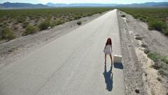 Sexy leg hitchhiker desert highway Stock Footage