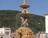 Stock Video Footage of tilt up large baroque fountain at Residenzplatz, historic center of Salzburg