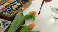 Painting with paintbrush green leaves of tulip in watercolors. - stock footage