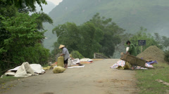 Farmers busy on the streets in Mai Châu, Vietnam Stock Footage