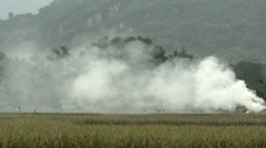 Smoke above farm land in Mai Châu Stock Footage