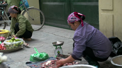 Woman cutting fish in the streets of Hanoi, Vietnam Stock Footage