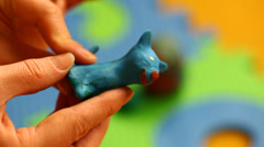 Woman's hands with play dough Stock Footage