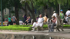 Elderly man working out and talking with each other near the Hoàn Kiếm Lake Stock Footage