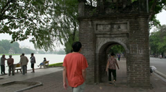 People walking around the Hoàn Kiếm Lake in Hanoi, Vietnam Stock Footage