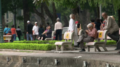 Elderly man working out near the Hoàn Kiếm Lake Stock Footage