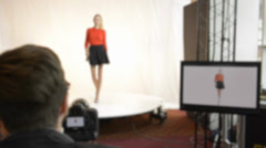 Model walking for a photoshoot (1 of 5) Stock Footage