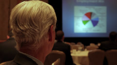 Man observing a business presentation - stock footage