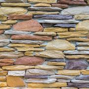 Layers of colorful stones wall as texture - stock photo