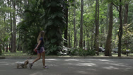 Stock Video Footage of 056 Sao Paulo, Ibirapuera park, slowmotion sexy woman with dog, runners