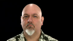 A fat bald white man makes an undecided face - stock footage