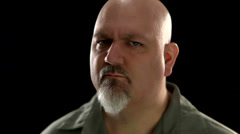 A fat bald white man makes a scary mean face - stock footage