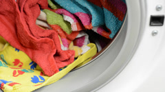 Colorful clothes in washing machine Stock Footage