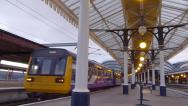 Stock Video Footage of Northern Rail 142 Pacer train leaving York railway station Yorkshire