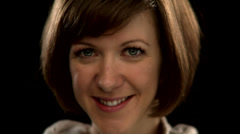 A woman with short hair smiles at the camera Stock Footage