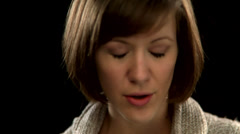 A woman with short hair takes a deep breath - stock footage