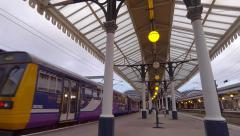 Northern Rail 142 Pacer train arriving at York railway station Yorkshire Stock Footage