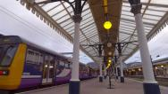 Stock Video Footage of Northern Rail 142 Pacer train arriving at York railway station Yorkshire