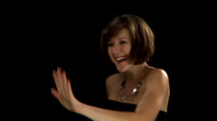 A woman with short hair looks at the ring on her hand Stock Footage