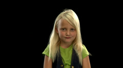 An adorable young blonde girl pouts - stock footage