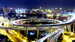 4k-Time lapse,traffic lights trail & vehicles on overpass bridge at night. Stock Footage