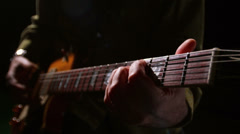 Close up of a man's two hands playing a song on a guitar Stock Footage