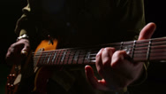Stock Video Footage of Close up of a man's two hands playing a song on a guitar