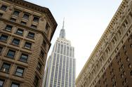 Stock Photo of empire state building between buildings