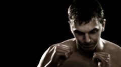 Man shadow boxing Stock Footage
