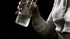 Close up of a sweaty woman drinking water after a intense workout. Stock Footage
