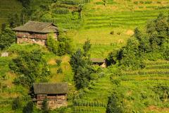 Old wooden village buildings in hill Stock Photos