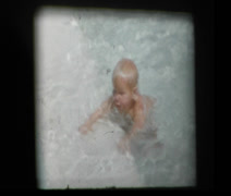 Happy Infant Baby playing in big pool learning to swim Stock Footage