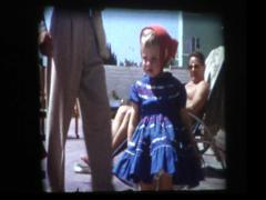 Cute little 50s girl in blue dress and red bonnet Stock Footage