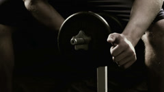 Close up of a sweaty male athlete doing arm curls with a dumbbell Stock Footage