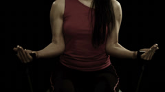 A woman uses hand weights during her exercise routine Stock Footage
