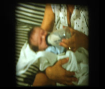 Mom feeding newborn infant baby bottle - stock footage