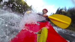 Slow motion whitewater kayaker Stock Footage