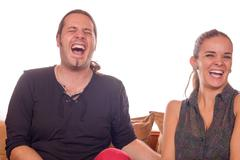 couple dying of laughter - stock photo