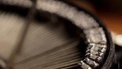 Rack focus across typewriter levers as man types Stock Footage