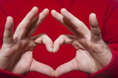Heart shaped gesture Stock Photos