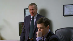 A younger office worker gets a verbal beating from his unhappy boss Stock Footage