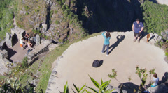 Machu Picchu wide angle in time lapse at distance as people look at it from afar Stock Footage